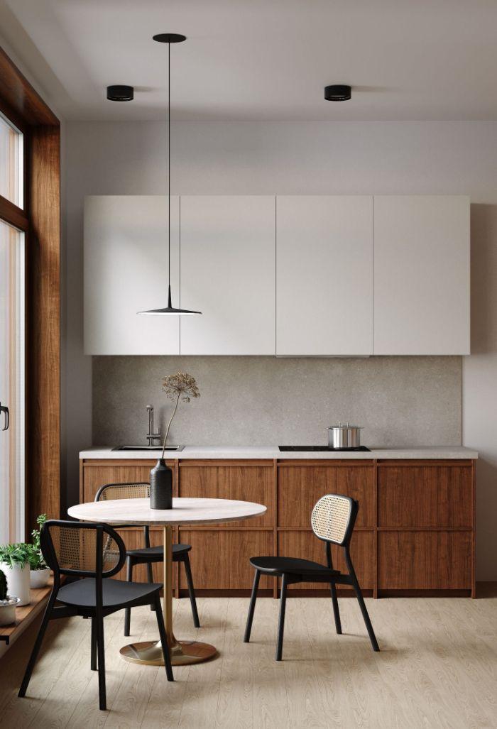 meuble cuisine bas bois et meuble haut blanc table ronde entourée de chaises metal noir parquet bois clair
