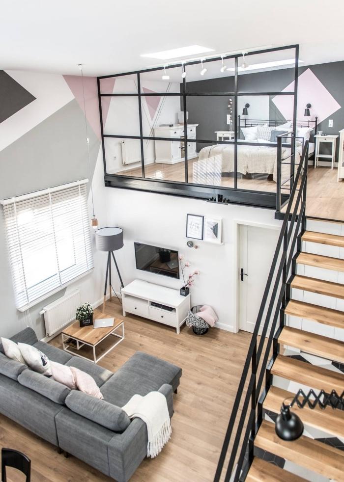 mezzanine loft design intérieur style moderne peinture géométriques lampe sur pied gris meuble bois