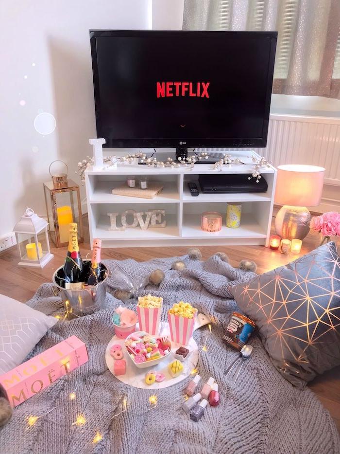 saint valentin celibataire un tele qui diffuse netflix une champqgne dans un seau et des popcorns