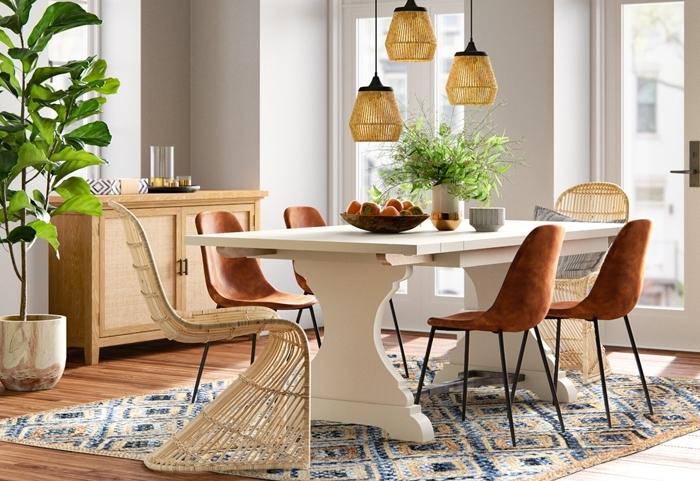salle a manger moderne table bois blanc chaise tressée rotin chaise velours marron pieds métal noirci