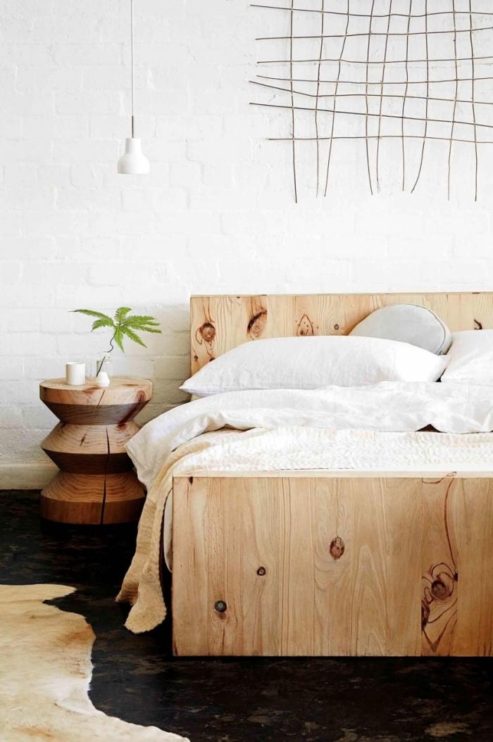 tête de lit en bois cadre lit rustique deco murale originale grillage lampe suspendue blanche mur briques blanches