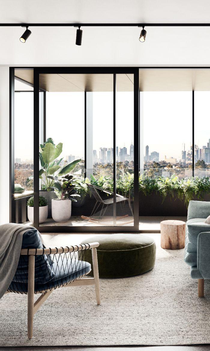 verrière industrielle extérieure apprtement ambiance japonaise scandinave canapé chaise bleu table matelassée verte table tronc bois