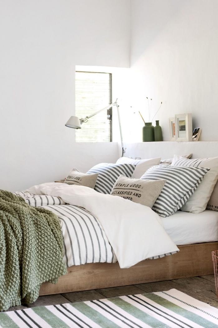 décoration chambre à coucher blanche meubles bois cadre de lit bois couleur vert kaki vase vert