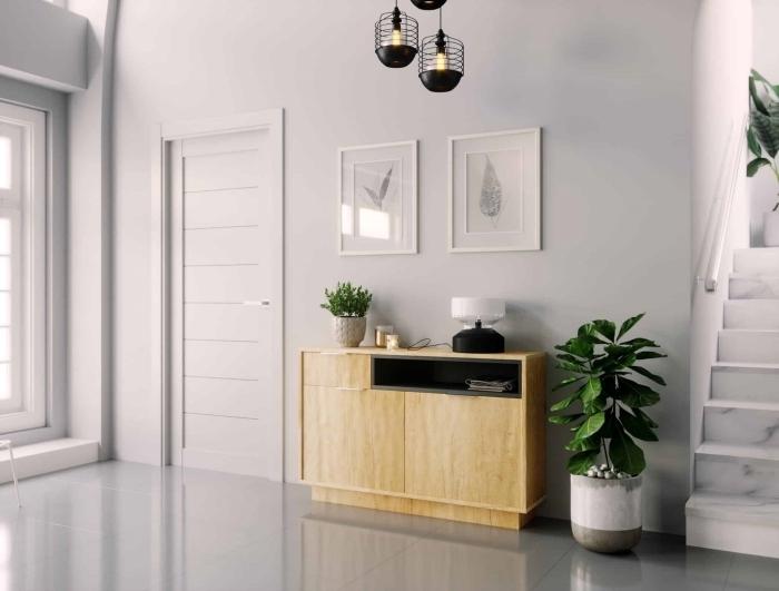 décoration entrée accueillante peinture murale blanche meuble bois pot fleur blanc et béton