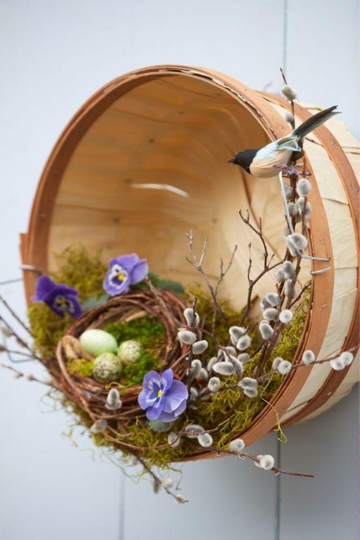 panier décoré de branches artificielles mousse florale nid aux oeufs oiseau deco printemps murale originale