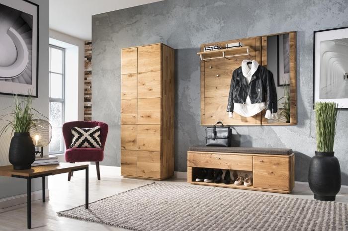 peinture couloir à effet béton meubles en bois table bois et métal fauteuil velours vase noir mat