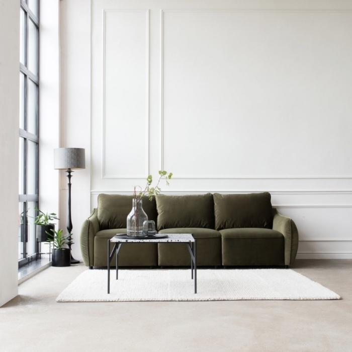 salon blanc lampe sur pied gris et noir couleurs qui vont avec le kaki tapis blanc canapé vert foncé
