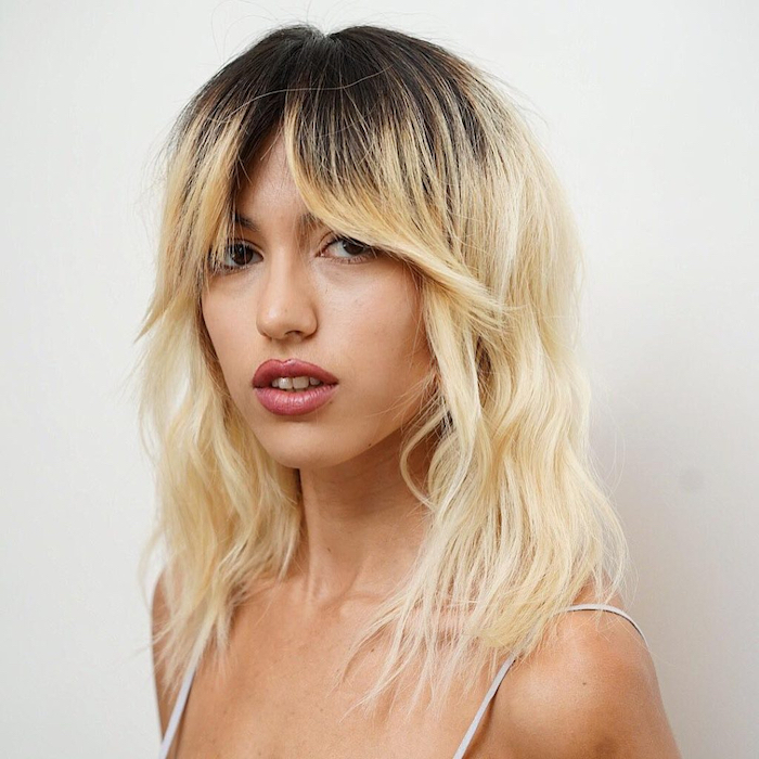 newest shaggy bob hairstyles with curtain bangs within women's messy platinum blonde wavy textured lob with fringe curtain