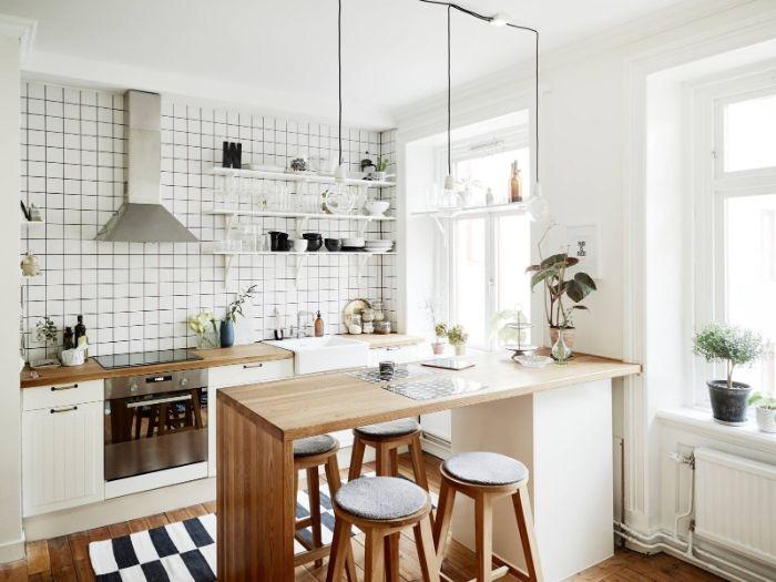 aménagement cuisine ouverte d appartement couleur blanche carrelage blanc et ilot de cuisine bois entouré de tabourets