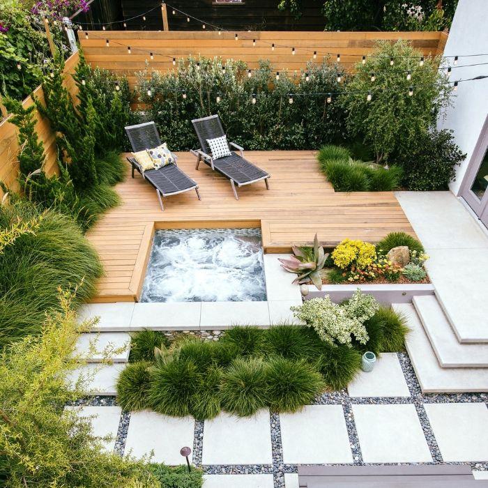 arbustes vertes bordure verte aménager une terrasse extérieure en bois bassin balnéo dalles sur gravier