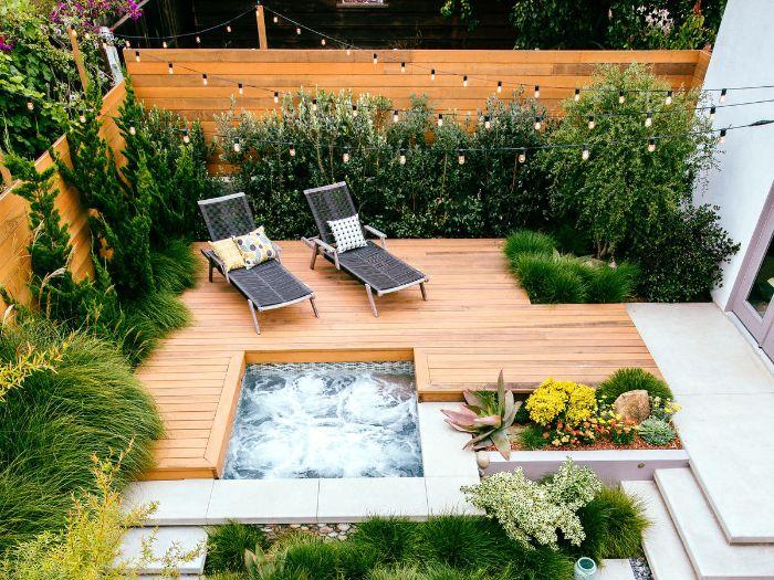 bassin de jardinplantes vertes bordure jardin amenagement terrasse exterieur guirlande ampoules galets decoratifs