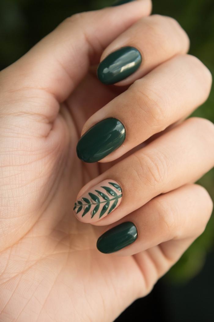 couleur ongles en gel printemps vernis nuance vert foncé dessin sur un ongle motif feuille verte
