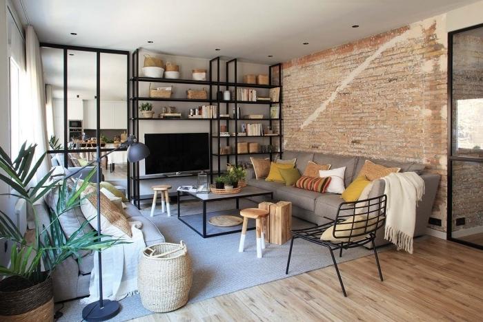 déco loft industriel design moderne parquet bois stratifié mur en rbiques rouges étagère en métal
