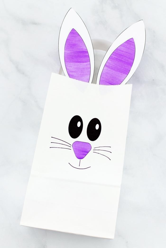 décoration de paques à fabriquer avec les enfants diy sac pochette en papier blanc dessin visage moustache lapin