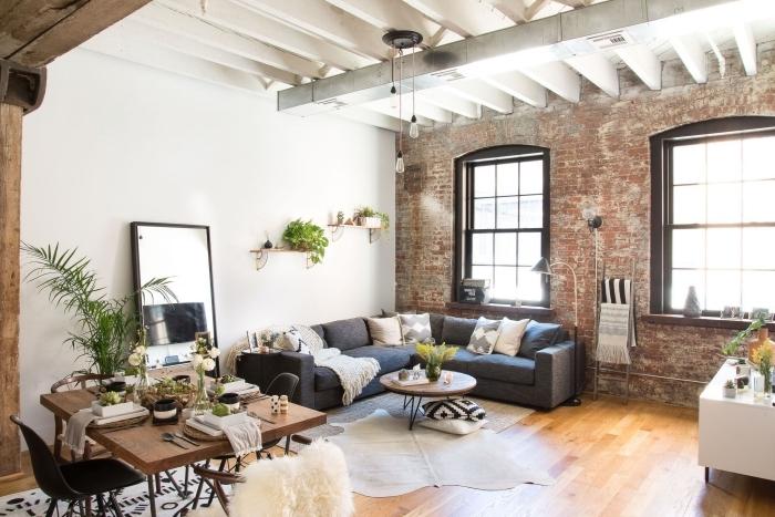 décoration intérieure boho minimaliste style salon cocooning chaleureux canapé d angle gris