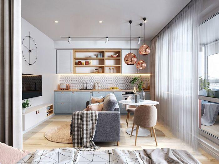 facade meuble cuisine bleu ciel meuble haut blanc parquet bois clair suspensions cuivre ouverture sur salon coin repas