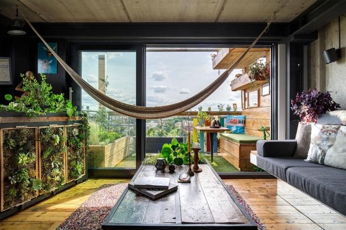 hamac suspendu intérieur boho industriel style parquet bois deco salon industriel moderne table industrielle