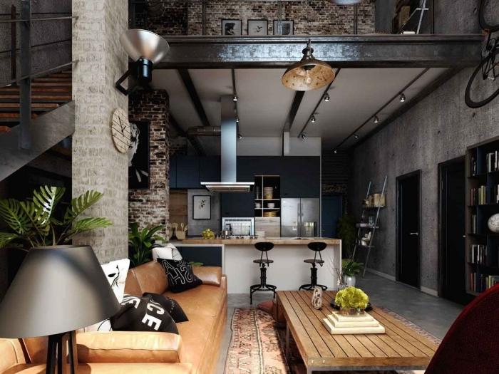 loft industriel table basse bois îlot bar chaise métal lampe monstera escalier bois et métal mur béton