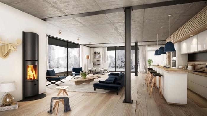 plafond béton parquet bois salon style industriel moderne cheminée noire tabouret bois et blanc