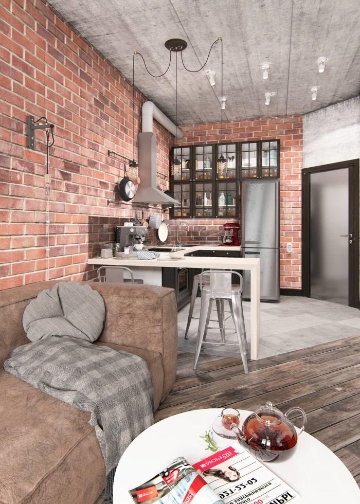 style industriel salon mur en briques rouges plafond béton ciré éclairage industriel canapé marron