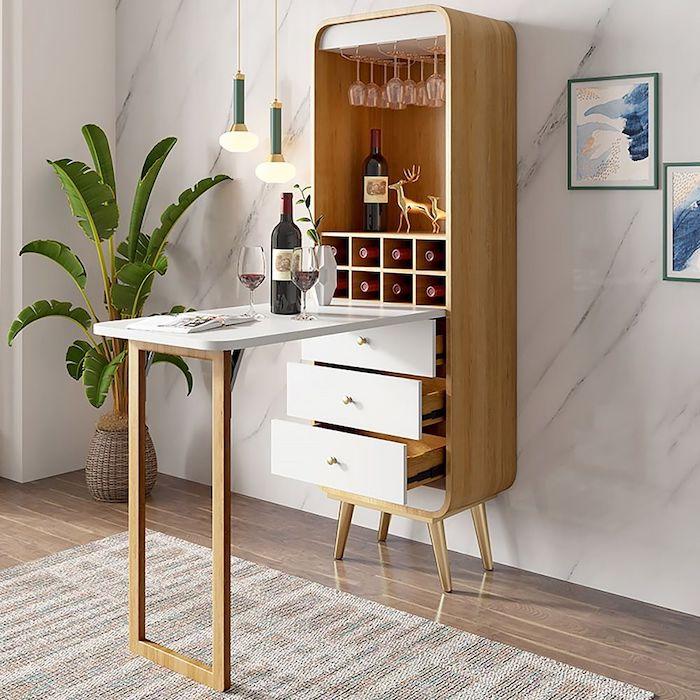 une idée d économiser le petit espace avec une table retracable ed bouteille au vin au dessus