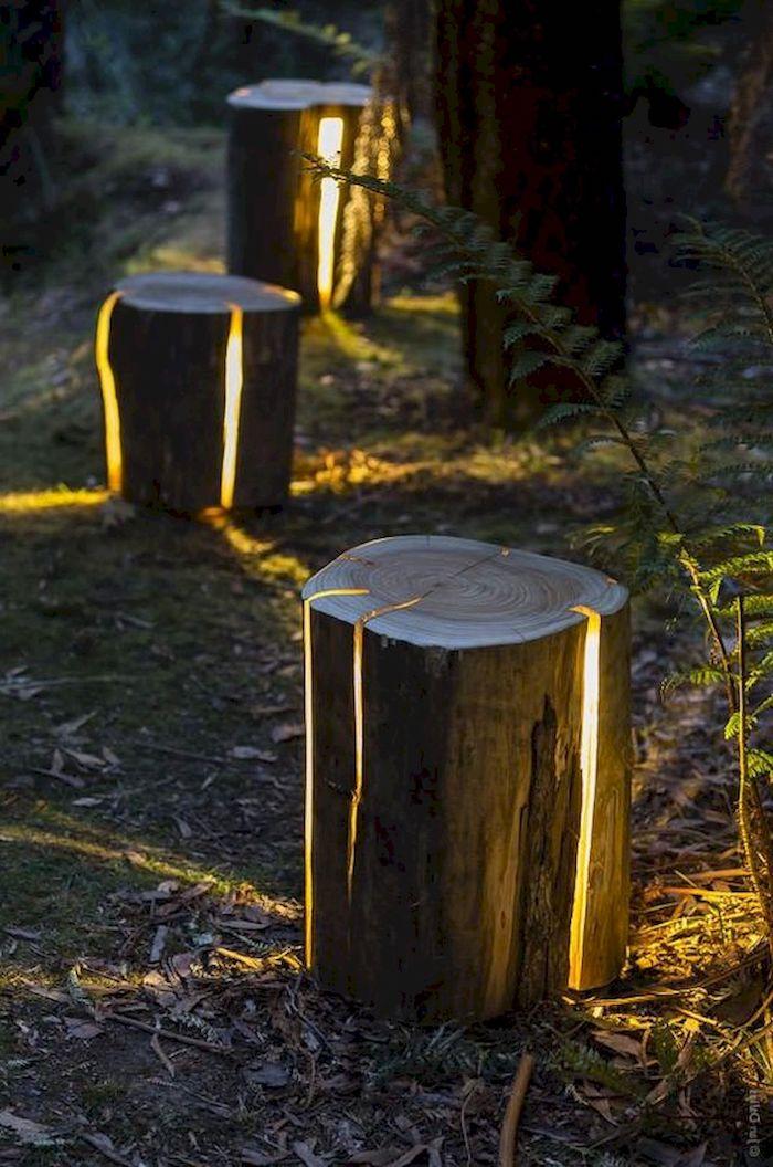 une idée de la lumiere cache dans des troncs pour le jardin ou la cour