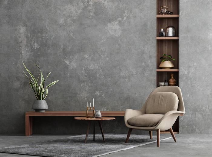 amenagement optimiser interieur un fauteuil devant table basse en bois et une etagere
