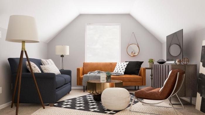 amenagement sous pente canapé gris anthracite table basse or pouf blanc fauteuil marron