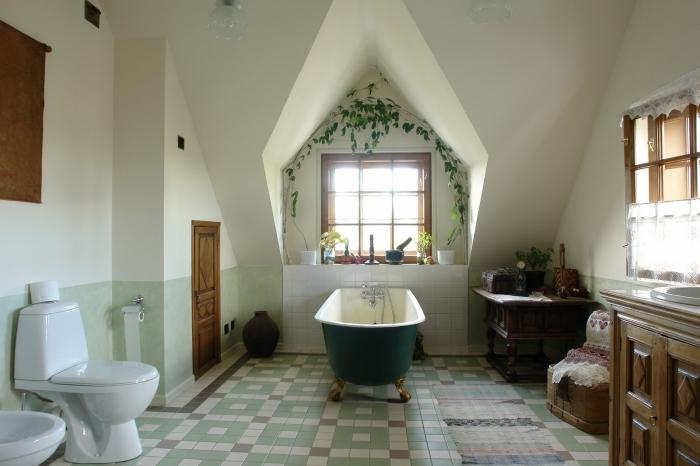 baignoire autoportante vert foncé meuble salle de bain rustique plante bain carrelage vert pastel