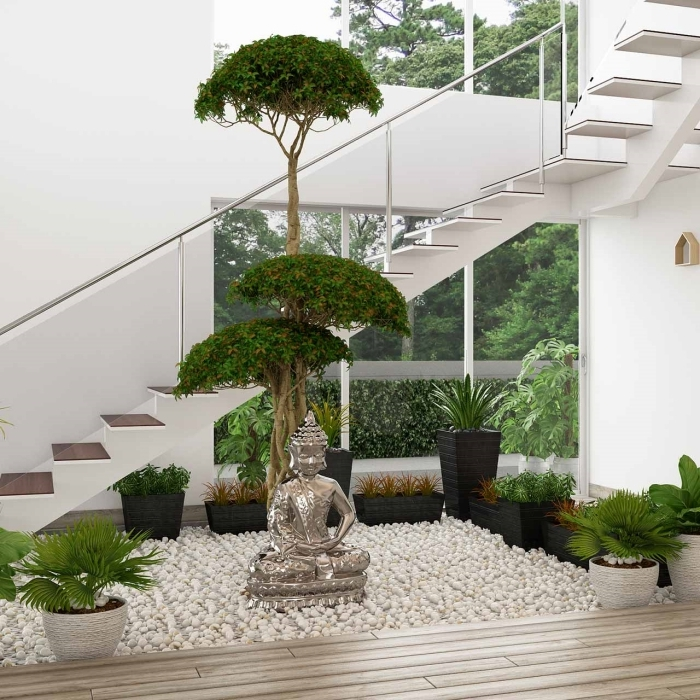 décoration jardin zen intérieur aménagement sous escalier sans contremarche galets blancs statue bouddha