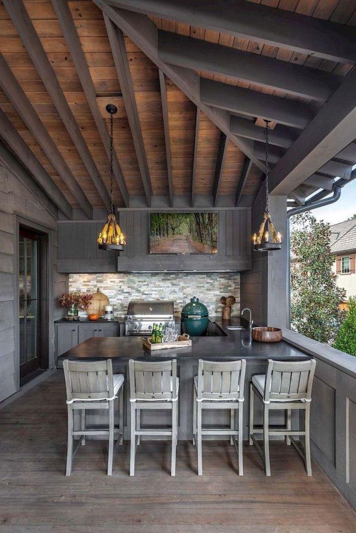 deco en peinture gris pour une extension cuisine veranda avec table a manger et chaises et un coin de cuisiner