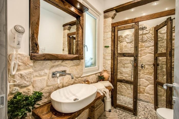 design salle de bain rustique avec murs en pierre miroir en bois brut meuble sous lavabo peinture blanche