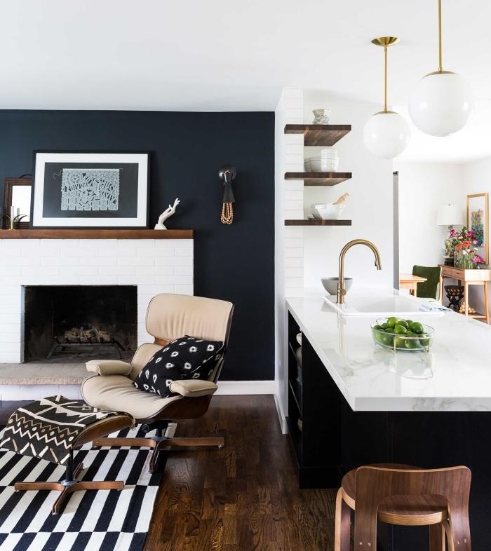 design salon moderne ouvert vers cuisine îlot plan travail marbre peinture murale sombre cheminée