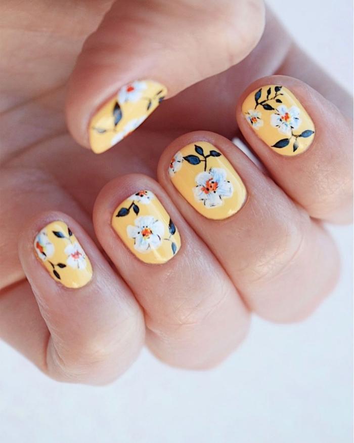 dessin ongle facile printemps manucure couleur tendance jaune vernis a ongles dessin fleur blanche