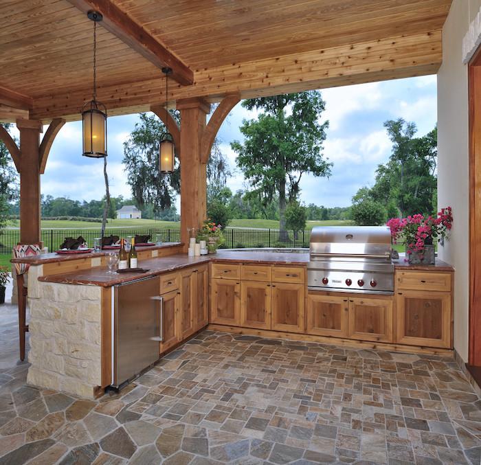 idee deco veranda en style contemporain avec une vue qui donne aux champs et des placards en bois