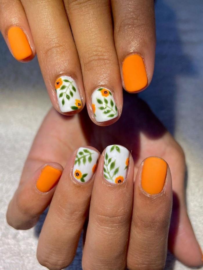 manucure printemps couleurs dessins floraux nail art dessin simple fleur orange vernis finition mate