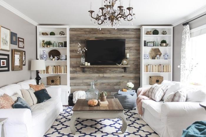 panneau mural tv en bois rangement mural étagère mur de cadres lustre cristaux table basse