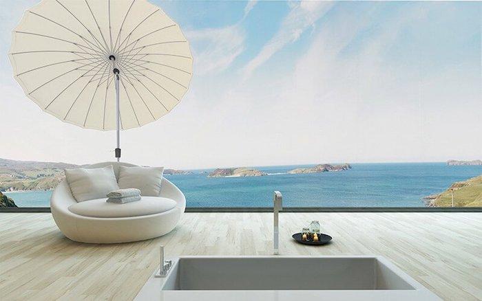 parasol rond carré ou rectangulaire pour une terrasse e n bois avec canapé blanc et jaccuzzi vue sur la mer