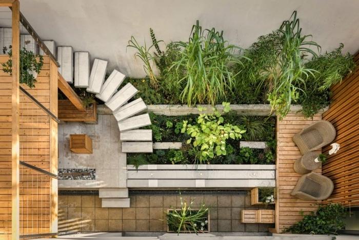 petit jardin japonais zen chaise rotin escalier torsadé revetement sol dalles terrasse bois plantes