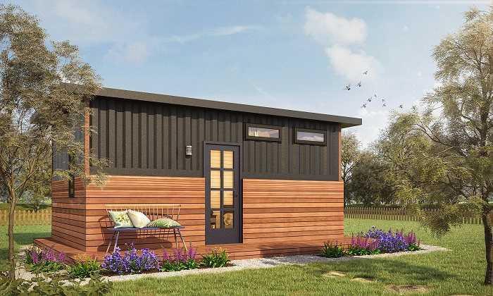studio de jardin en bois sans permis de construction pelouse verte fleurs
