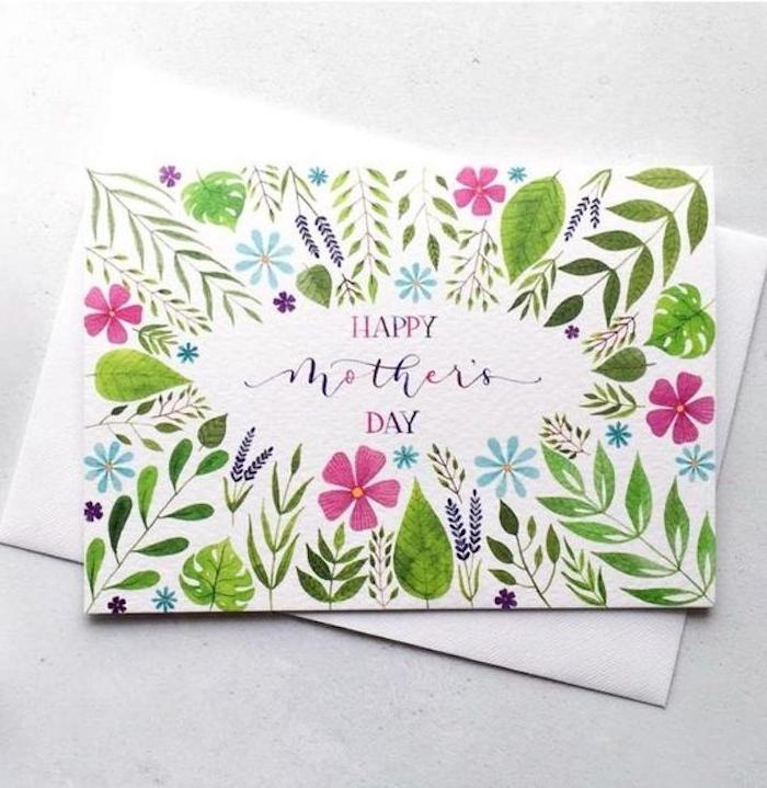 une carte pour la fete de maman avec une multitudes des fleurs peints a l auqrelle