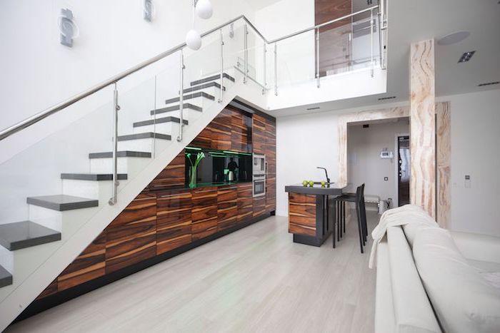 cuisine bois laquée avec éclairage led vert ilot central bois et plan de travail gris chaises bar noiresescalier blanc et gris