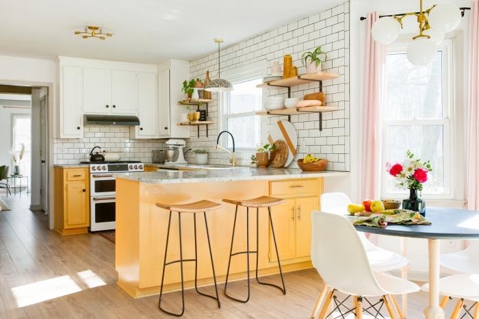 deco boheme salon ouvert design coin a manger table ronde chaise bois et blanc crédence métro