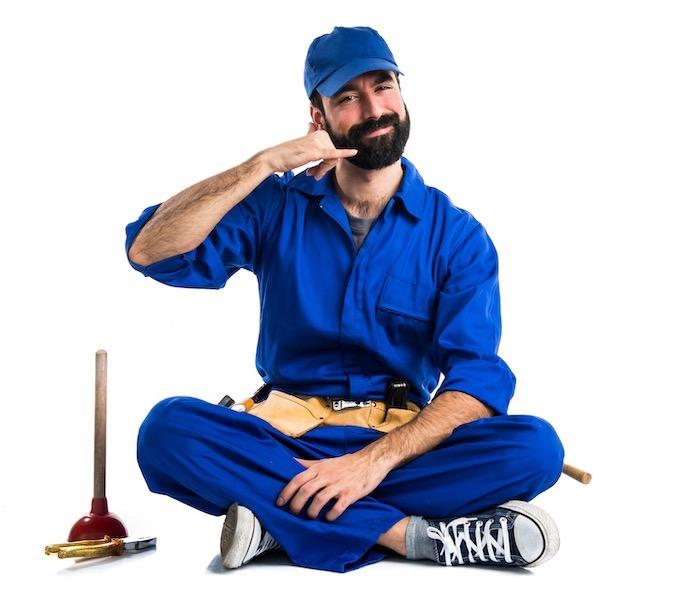 plumber making phone gesture