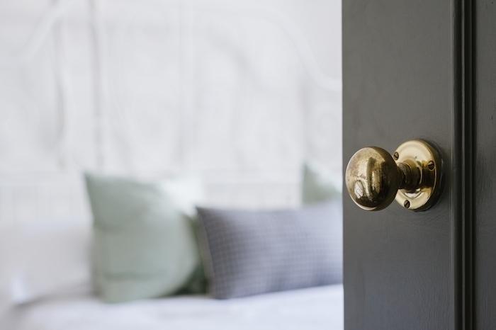 closeup shot of a gold door knob on a black door