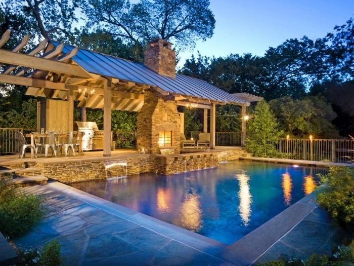 éclairage extérieur solaire piscine jet eau aménagement paysager autour d une piscine barbecue pierre