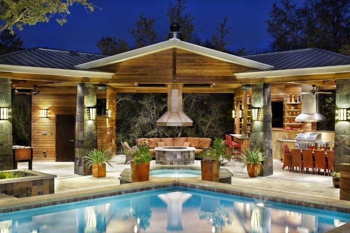 amenagement piscine design extérieure hotte canapé cuir équipement cuisine inox plantes vertes
