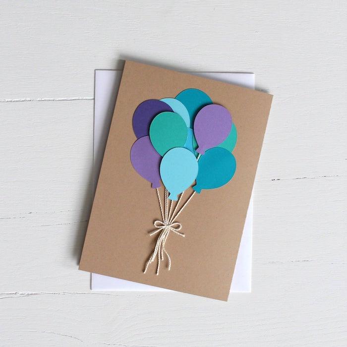 ballons de papier bleu et et mauve avec des fils sur papier kraft cadeau fete des peres diy