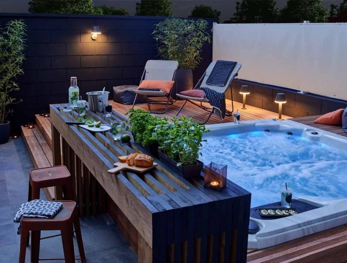 bar bois cuisine exterieure tabourets de bar herbes plantes jardin éclairage extérieur chaise longue