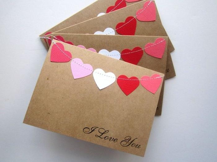 carte fete des peres maternelle coeurs de papier guirlande sur papier kraft message je t aime